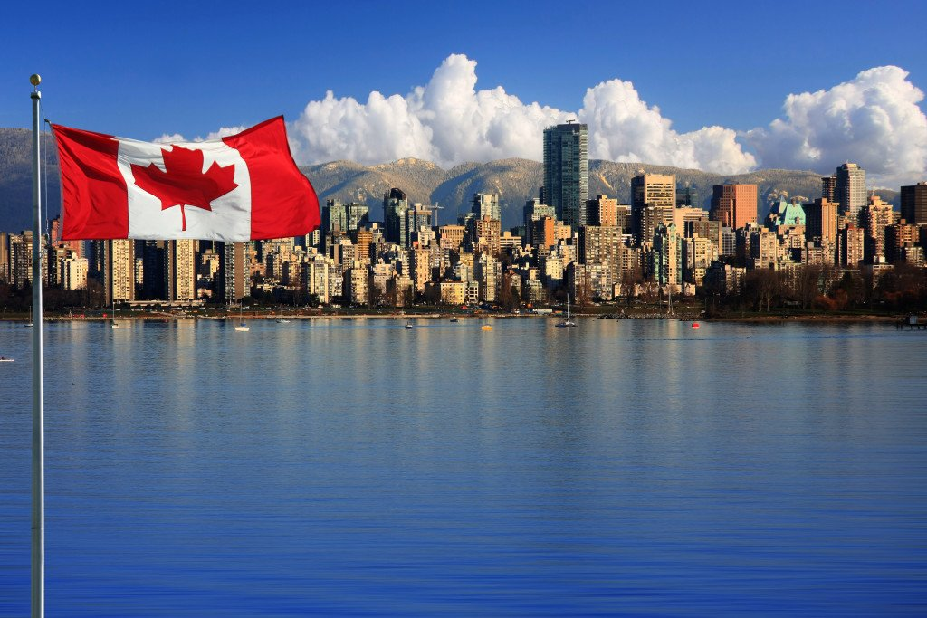 Canadian flag in front of the beautiful city of Vancouver, Canad